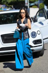 christine-chiu-in-a-leather-vest-and-blue-bottoms-at-the-ivy-in-la-03-01-2021-2.jpg