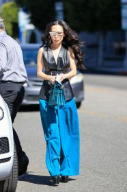 christine-chiu-in-a-leather-vest-and-blue-bottoms-at-the-ivy-in-la-03-01-2021-3.jpg